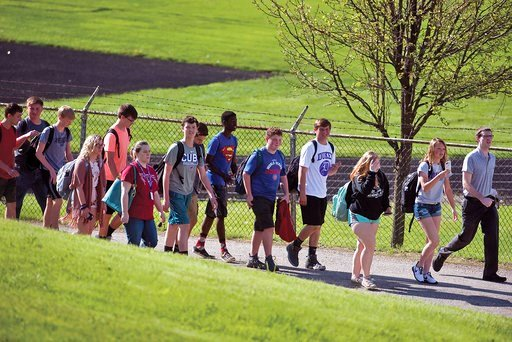 (Alex T. Paschal/Sauk Valley Media via AP). Students file into the adjacent National Guard armory following a shooting at Dixon High School Wednesday, May 16, 2018, in Dixon, Ill. A 19-year-old who showed up at his former high school in northern Illino...