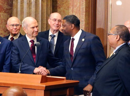 (AP Photo/Rick Bowmer). Mormon church President Russell M. Nelson shakes hands with Derrick Johnson, president of the NAACP during a news conference Thursday, May 17, 2018, in Salt Lake City. Top leaders from the NAACP and Mormon church are calling for...