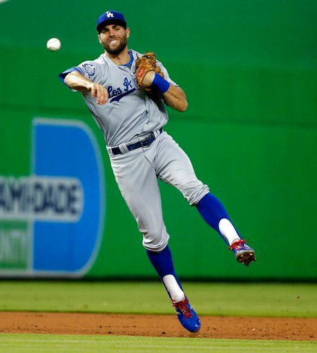 (AP Photo/Wilfredo Lee). Los Angeles Dodgers shortstop Chris Taylor throws to first to put out Miami Marlins' Bryan Holaday in the third inning of a baseball game, Thursday, May 17, 2018, in Miami.