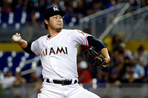 (AP Photo/Wilfredo Lee). Miami Marlins' Junichi Tazawa, of Japan, delivers a pitch during the fourth inning of a baseball game against the Los Angeles Dodgers, Thursday, May 17, 2018, in Miami.