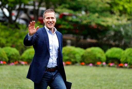 (AP Photo/Jeff Roberson). Missouri Gov. Eric Greitens waives to supporters as he walks to the podium to announce the release of funds for the state's biodiesel program Thursday, May 17, 2018, in Jefferson City, Mo.