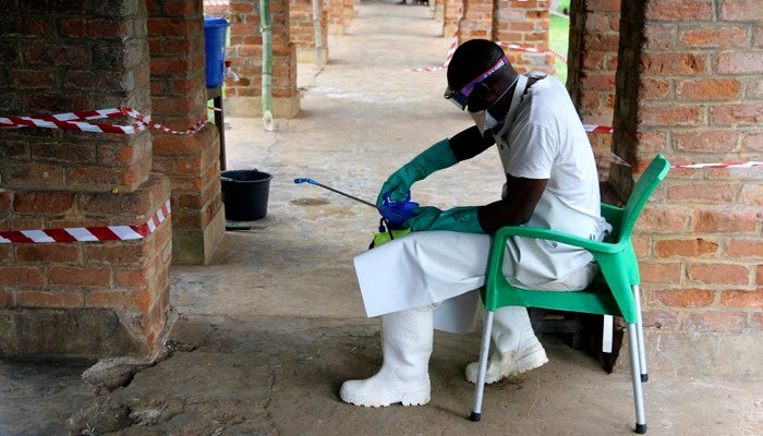 a health care worker wears virus protective gear at a treatment center in Bikoro Democratic Republic of Congo. (Source: AP Photo/John Bompengo)