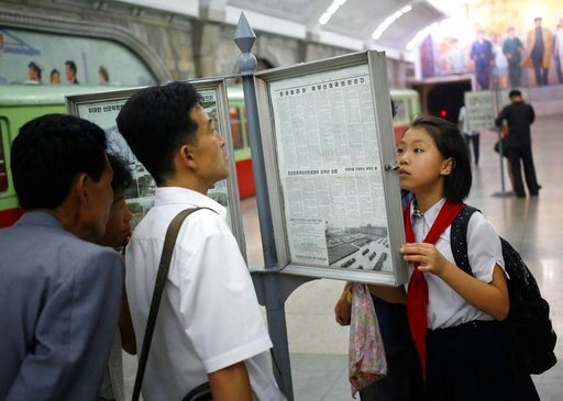 (AP Photo/Dita Alangkara, File). FILE - In this Aug. 22, 2015, file photo, people read the newspaper at a subway train platform in Pyongyang, North Korea. Donald Trump and Kim Jong Un have one big thing in common as they prepare for what would be the f...