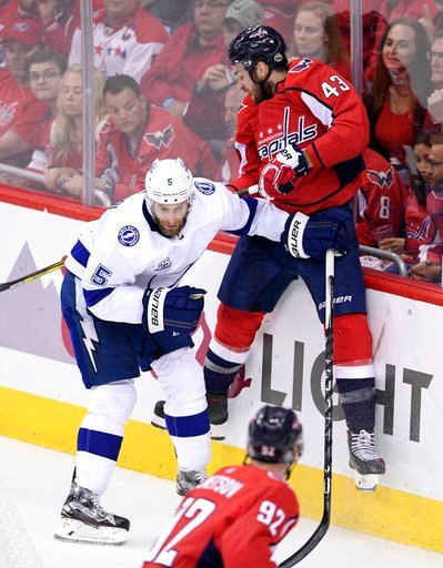 (AP Photo/Nick Wass). Washington Capitals right wing Tom Wilson (43) hits the boards next to Tampa Bay Lightning defenseman Dan Girardi (5) during the first period of Game 4 of the NHL hockey Eastern Conference finals Thursday, May 17, 2018 in Washingt...