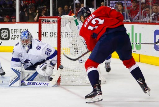 (AP Photo/Pablo Martinez Monsivais). Tampa Bay Lightning goaltender Andrei Vasilevskiy (88) stops a shot by Washington Capitals left wing Jakub Vrana (13) during the second period of Game 4 of the NHL Eastern Conference finals hockey playoff series, Th...