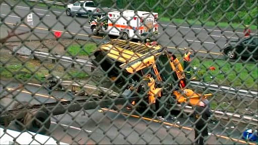 (WABC-TV via AP). This image taken from WABC-TV video shows an overturned school bus after it collided with a dump truck, injuring multiple people, on Interstate 80 in Mount Olive, N.J., Thursday, May 17, 2018.