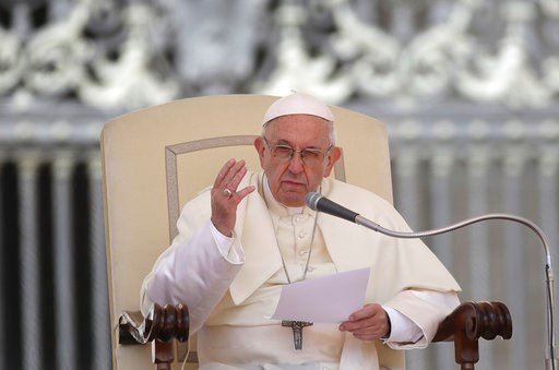 (AP Photo/Alessandra Tarantino). Pope Francis reads his message during his weekly general audience in St. Peter's Square at the Vatican, Wednesday, May 16, 2018. Pope Francis warned Wednesday that the latest spasm of violence in the Holy Land is only h...