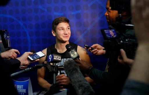 (AP Photo/Charles Rex Arbogast). Grayson Allen, from Duke, listens to a question as he speaks with reporters at the NBA draft basketball combine Thursday, May 17, 2018, in Chicago.