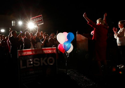 (AP Photo/Matt York, File). FILE - In this April 24, 2018, file photo, U.S. Rep. Debbie Lesko, R-Ariz., right, celebrates her congressional win at her home in Peoria, Ariz. Democrats hope that a primary between three Republicans helps them get a shot a...