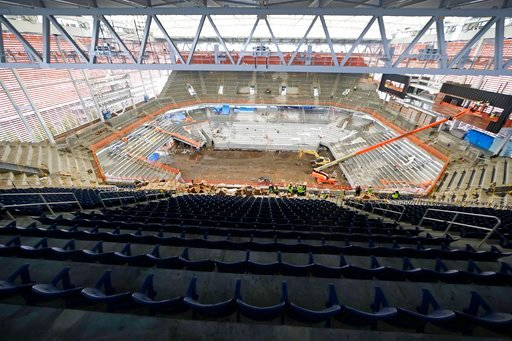 (AP Photo/Frank Franklin II). Construction crews work on the Louis Armstrong Stadium at the Billie Jean King National Tennis Center Thursday, May 17, 2018, in New York.