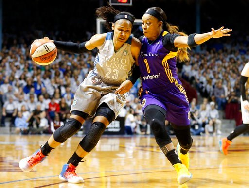 (AP Photo/Jim Mone, File). FILE - In this Oct. 4, 2017, file photo, Minnesota Lynx's Maya Moore, left, drives around Los Angeles Sparks' Odyssey Sims during the first half of Game 5 of the WNBA Finals in Minneapolis. The two teams have developed quite ...