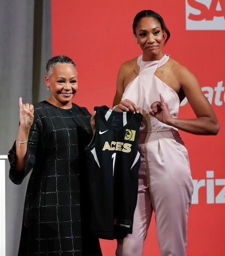 (AP Photo/Julie Jacobson, File). FILE - In this April 12, 2018, file photo, South Carolina's A'ja Wilson, right, poses for a photo with WNBA President Lisa Borders after being selected as the No. 1 overall pick by the Las Vegas Aces in the WNBA basketb...