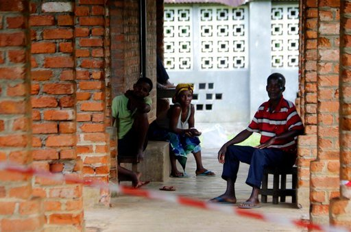 (AP Photo/John Bompengo). In this photo taken on Sunday, May 13, 2018, people suspected of having the Ebola Virus wait at a treatment center in Bikoro Democratic Republic of Congo. Congo's latest Ebola outbreak has spread to a city of more than 1 milli...