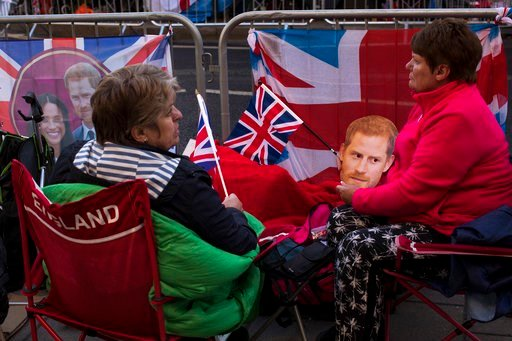 (AP Photo/Emilio Morenatti). Fans spend the night in front of Windsor castle, England, Friday, May 18, 2018. Preparations continue in Windsor ahead of the royal wedding of Britain's Prince Harry and Meghan Markle Saturday May 19.