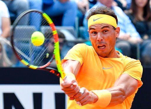 (Ettore Ferrari/ANSA via AP). Spain's Rafael Nadal returns the ball to Italy's Fabio Fognini during a quarter final match at the Italian Open tennis tournament in Rome, Friday, May 18, 2018.