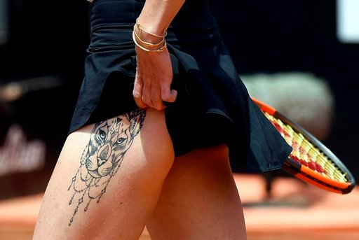 (Claudio Onorati/ANSA via AP). Ukraine's Elina Svitolina sports a tattoo on her leg during a quarter final match against Germany's Angelique Kerber at the Italian Open tennis tournament in Rome, Friday, May 18, 2018.