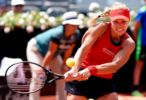 (Claudio Onorati/ANSA via AP). Germany's Angelique Kerber returns the ball to Ukraine's Elina Svitolina during a quarter final match at the Italian Open tennis tournament in Rome, Friday, May 18, 2018.