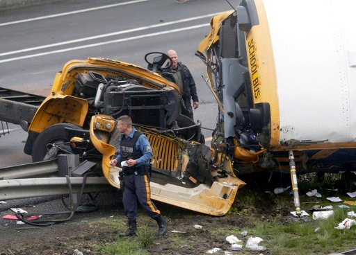 (AP Photo/Seth Wenig). Emergency personnel work at the scene of a school bus and dump truck collision, injuring multiple people, on Interstate 80 in Mount Olive, N.J., Thursday, May 17, 2018.
