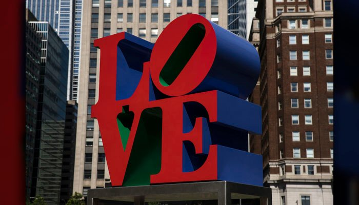 Robert Indiana, best known for his 1960s LOVE series – including the shown sculpture in John F. Kennedy Plaza in Philadelphia – died from respiratory failure Saturday, May 19, 2018. (AP Photo/Matt Rourke)