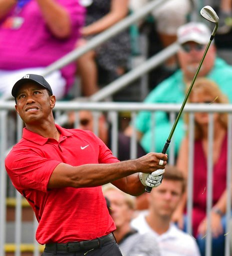 (AP Photo/David Dermer). Tiger Woods follows his shot from the rough on the seventh hole during the final round of the Memorial golf tournament Sunday, June 3, 2018, in Dublin, Ohio.