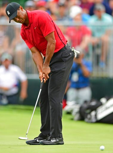 (AP Photo/David Dermer). Tiger Woods follows his putt on the seventh hole during the final round of the Memorial golf tournament Sunday, June 3, 2018, in Dublin, Ohio.