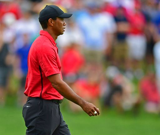 (AP Photo/David Dermer). Tiger Woods walks to the green on the seventh hole during the final round of the Memorial golf tournament Sunday, June 3, 2018, in Dublin, Ohio.