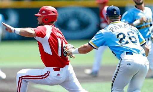 (Brad Tollefson/Lubbock Avalanche-Journal via AP). Kent State's Pavin Parks (26) tags out Louisville's Justin Lavey (16) during an NCAA college baseball tournament regional game Sunday, June 3, 2018, in Lubbock, Texas.