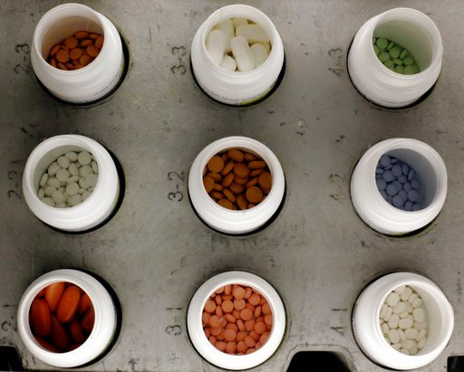 (AP Photo/Matt Rourke, File). In this June 14, 2011, file photo, various prescription drugs on the automated pharmacy assembly line at Medco Health Solutions in Willingboro, N.J.