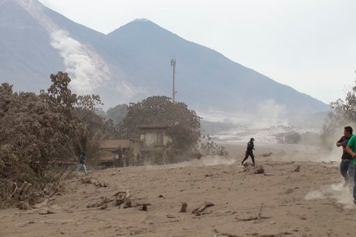 (AP Photo/Luis Soto). The Volcan de Fuego, or Volcano of Fire, continues to spill out smoke and ash as residents evacuate from Escuintla, Guatemala, Monday, June 4, 2018. A fiery volcanic eruption in south-central Guatemala sent lava flowing into rural...