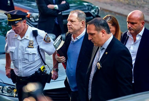 (AP Photo/Andres Kudacki, File). In this May 25, 2018, file photo, Harvey Weinstein arrives at the first precinct while turning himself to authorities following allegations of sexual misconduct in New York.