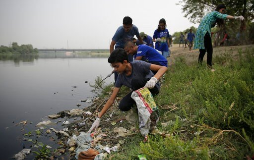 "(AP Photo/Altaf Qadri). Volunteers clean the banks of Yamuna, India's sacred river that flows through New Delhi, Tuesday, June 5, 2018. World Environment Day is observed during June 5. This year the theme is ""Beat Plastic Pollution""."