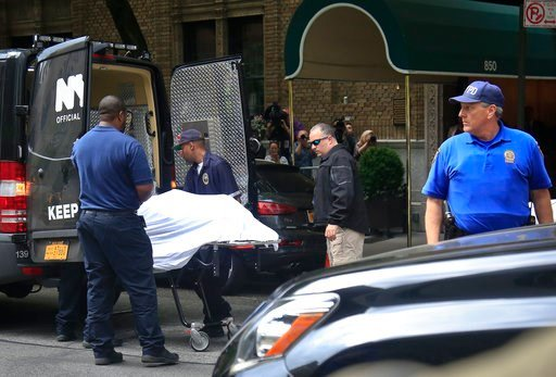 (AP Photo/Bebeto Matthews). The body of designer Kate Spade is removed from her apartment building in New York on Tuesday June 5, 2018. Spade was found hanged in her apartment Tuesday in an apparent suicide, law enforcement officials said.