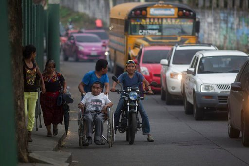 (AP Photo/Luis Soto). Residents evacuate after a new flow of searing hot volcanic material down the slopes of the Volcano of Fire in Escuintla, Guatemala, Tuesday, June 5, 2018. The volcano exploded Sunday, sending down hot clouds of gas and ash that k...