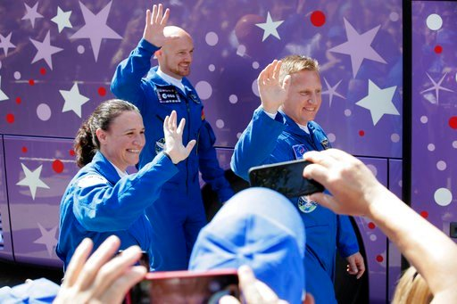 (AP Photo/Dmitri Lovetsky). U.S. astronaut Serena Aunon-Chancellor, left, Russian cosmonaut Sergey Prokopyev, right, and German astronaut Alexander Gerst, members of the main crew to the International Space Station (ISS), wave as they walk to a bus fro...