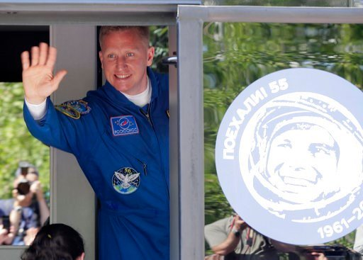 (AP Photo/Dmitri Lovetsky). Russian cosmonaut Sergey Prokopyev, member of the main crew to the International Space Station (ISS), waves from a bus prior the launch of Soyuz-FG rocket at the Russian leased Baikonur cosmodrome, Kazakhstan, Wednesday, Jun...