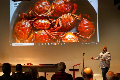 (AP Photos/Robert F. Bukaty). Jamie Bassett, a crabber from Chatham, Mass., gives presentation on culinary uses for the green crabs, at a conference, Wednesday, June 6, 2018, in Portland, Maine. Food scientists have gathered to find a way to monetize i...