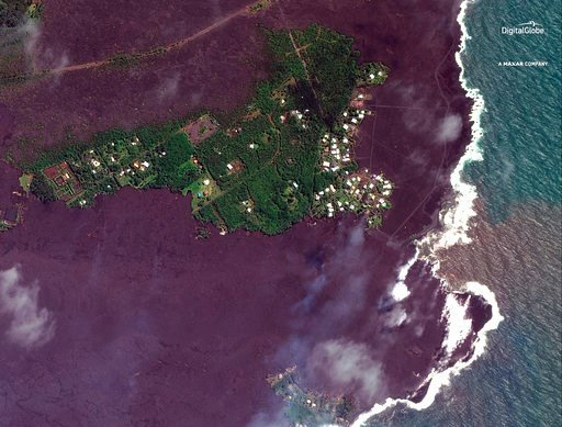 (Satellite Image ©2018 DigitalGlobe, a Maxar company via AP). This satellite image provided by Digital Globe captured June 5, 2018, shows lava flows on most of Kapoho Bay in Hawaii.   Lava from the Kilauea volcano destroyed hundreds of homes in a mostl...