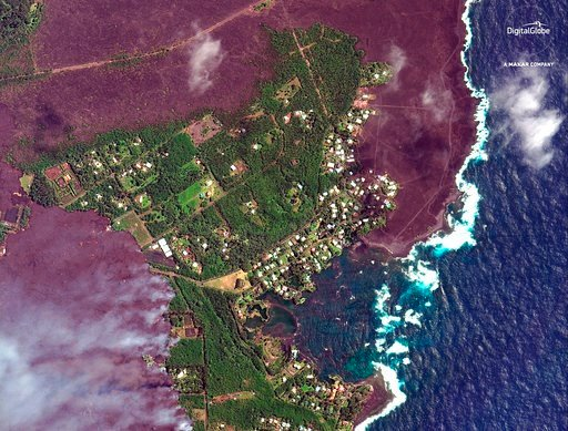 (Satellite Image ©2018 DigitalGlobe, a Maxar company via AP). This satellite image provided by Digital Globe captured June 3, 2018, shows advancing lava flows as they approach Kapoho Bay in Hawaii.   Lava from the Kilauea volcano destroyed hundreds of ...