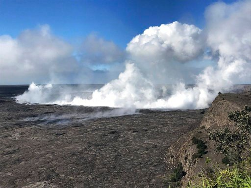 (U.S. Geological Survey via AP). This photo provided by the U.S. Geological Survey shows an early-morning view of Halema'uma'u Crater and the Kilauea Caldera from the Kilauea overlook at Hawaii Volcanoes National Park on the island of Hawaii, Tuesday, ...
