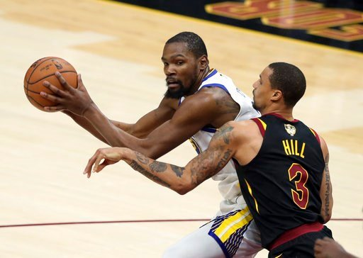 (AP Photo/Carlos Osorio). Golden State Warriors' Kevin Durant is defended by Cleveland Cavaliers' George Hill during the second half of Game 3 of basketball's NBA Finals, Wednesday, June 6, 2018, in Cleveland.