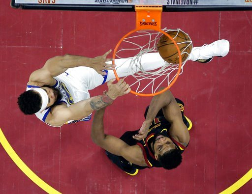 (AP Photo/Carlos Osorio, Pool). Golden State Warriors center JaVale McGee dunks over Cleveland Cavaliers center Tristan Thompson, right, during the second half of Game 3 of basketball's NBA Finals, Wednesday, June 6, 2018, in Cleveland.