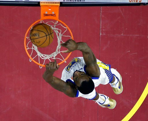 (AP Photo/Carlos Osorio, Pool). Golden State Warriors' Draymond Green dunks during the second half of Game 3 of basketball's NBA Finals against the Cleveland Cavaliers, Wednesday, June 6, 2018, in Cleveland.