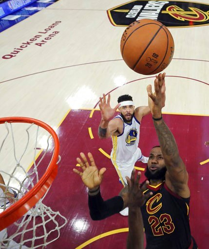 (Gregory Shamus/Pool Photo via AP). Cleveland Cavaliers' LeBron James shoots as Golden State Warriors' JaVale McGee watches during the first half of Game 3 of basketball's NBA Finals, Wednesday, June 6, 2018, in Cleveland.