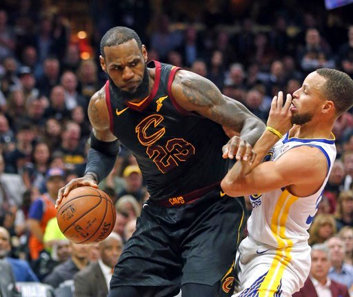 (Joshua Gunter/The Plain Dealer via AP). Cleveland Cavaliers forward LeBron James looks to move past Golden State Warriors guard Stephen Curry during the first half of Game 3 of basketball's NBA Finals on Wednesday, June 6, 2018, in Cleveland.