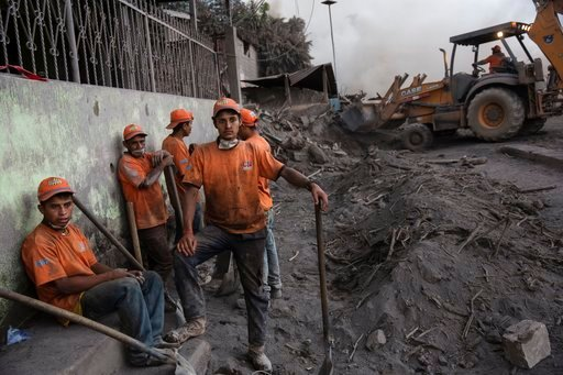 """(AP Photo/Rodrigo Abd). Rescue workers gather in the disaster zone covered in volcanic ash near the Volcan de Fuego, or """"Volcano of Fire, in the El Rodeo hamlet of Escuintla, Guatemala, Wednesday, June 6, 2018. Firefighters said the chance of finding a..."""