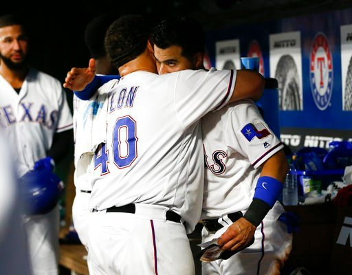 (AP Photo/Jim Cowsert). Texas Rangers' Bartolo Colon (40) is embraced by Robinson Chirinos, right, as he arrives in the dugout following the fifth inning of the team's baseball game against the Oakland Athletics, Wednesday, June 6, 2018, in Arlington, ...