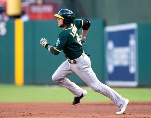 (AP Photo/Jim Cowsert). Oakland Athletics' Jed Lowrie runs to second on a double against the Texas Rangers during the first inning of a baseball game Wednesday, June 6, 2018, in Arlington, Texas.