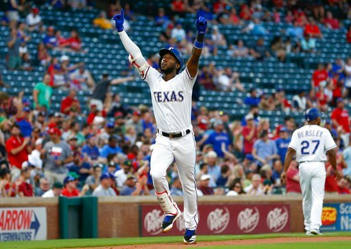 (AP Photo/Jim Cowsert). Texas Rangers' Jurickson Profar points to the sky as he arrives home following his solo home run against the Oakland Athletics during the third inning of a baseball game, Wednesday, June 6, 2018, in Arlington, Texas.