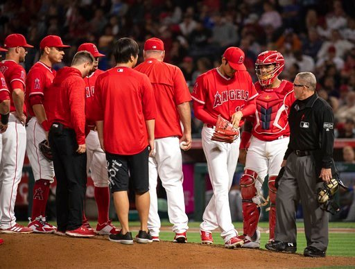 (AP Photo/Kyusung Gong). Los Angeles Angels starting pitcher Shohei Ohtani, third from right, is removed from the baseball game against the Kansas City Royals during the fifth inning in Anaheim, Calif., Wednesday, June 6, 2018.