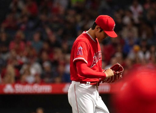 (AP Photo/Kyusung Gong). Los Angeles Angels starting pitcher Shohei Ohtani leaves the baseball game against the Kansas City Royals during the fifth inning in Anaheim, Calif., Wednesday, June 6, 2018.